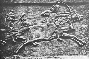 An Assyrian king, likely Ashurbanapal, hunting in Mesopotamia