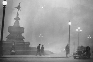 people walking in smog in Piccadilly Circus