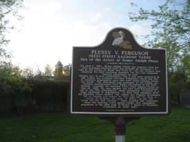 A sign pays tribute to the Plessy v. Ferguson case.