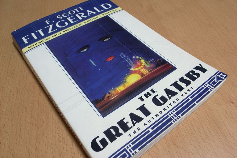 """""""The Great Gatsby"""" book laying on a wooden surface."""