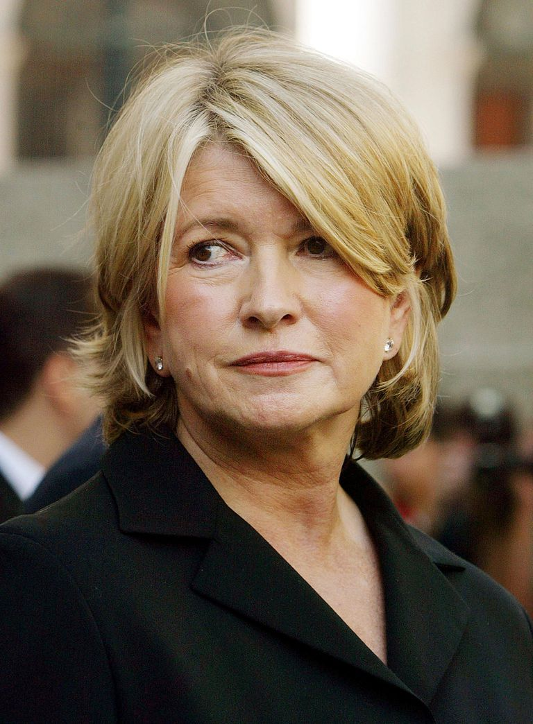 Martha Stewart standing in front of a group of people.