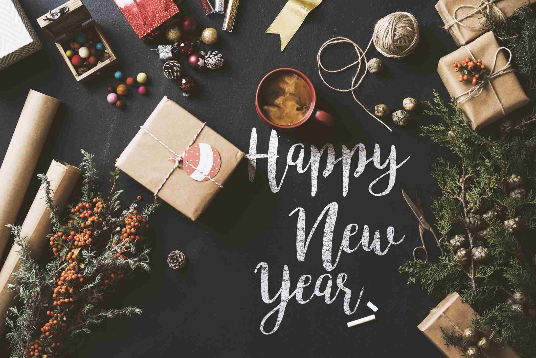 Calligraphy Happy New Year 2017 chalk written blackboard, flat lay