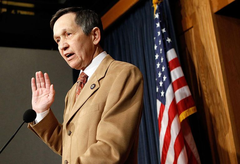 Dennis Kucinich speaking at a podium