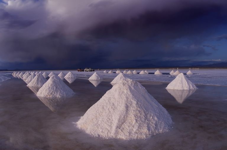 Sea salt is collected from evaporating it onto beaches, but it's still necessary to purify the salt by removing the sand residue.