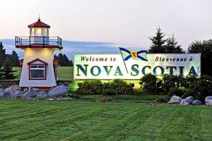 Welcome to Nova Scotia sign at twilight.