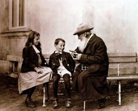 Russian writer Leo Tolstoy telling a story to his grandchildren