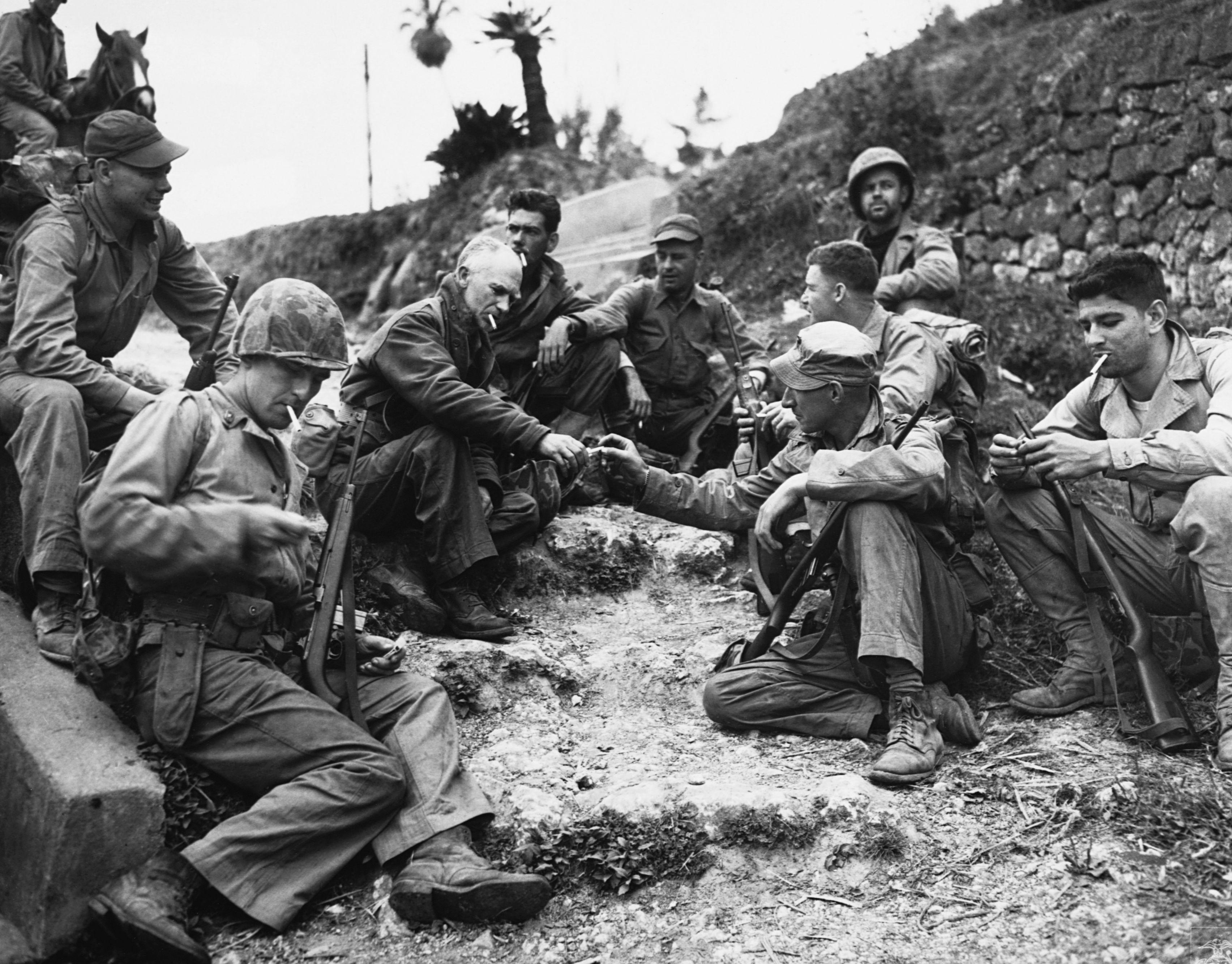 Ernie Pyle Smoking With Marines