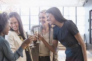 Businesswomen toasting with champagne in an office