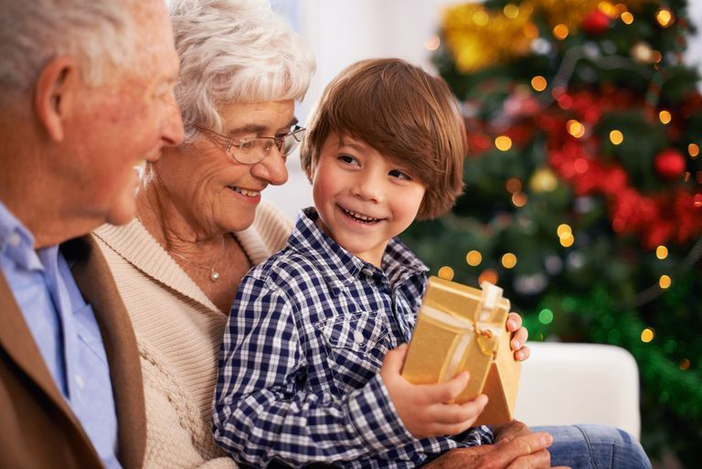 A child and his grandparents at Christmastime