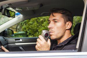 Man blowing into breathalyzer