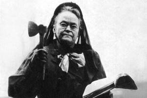 Carrie Nation, with axe and Bible