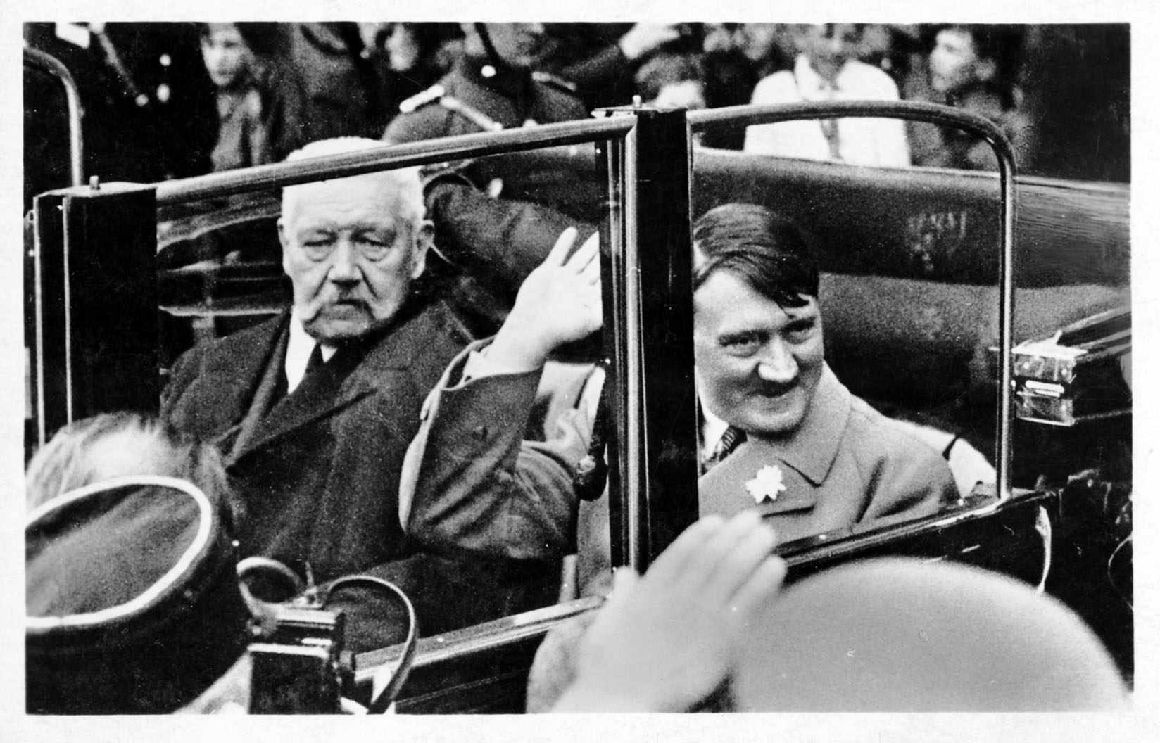 German President Paul von Hindenburg (1847 - 1934, left) in a car with Nazi leader and Chancellor of Germany, Adolf Hitler (1889 - 1945), on their way to a Labour Day youth rally at the Lustgarten, Berlin, 1st May 1933.