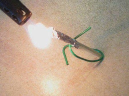A lit match rocket