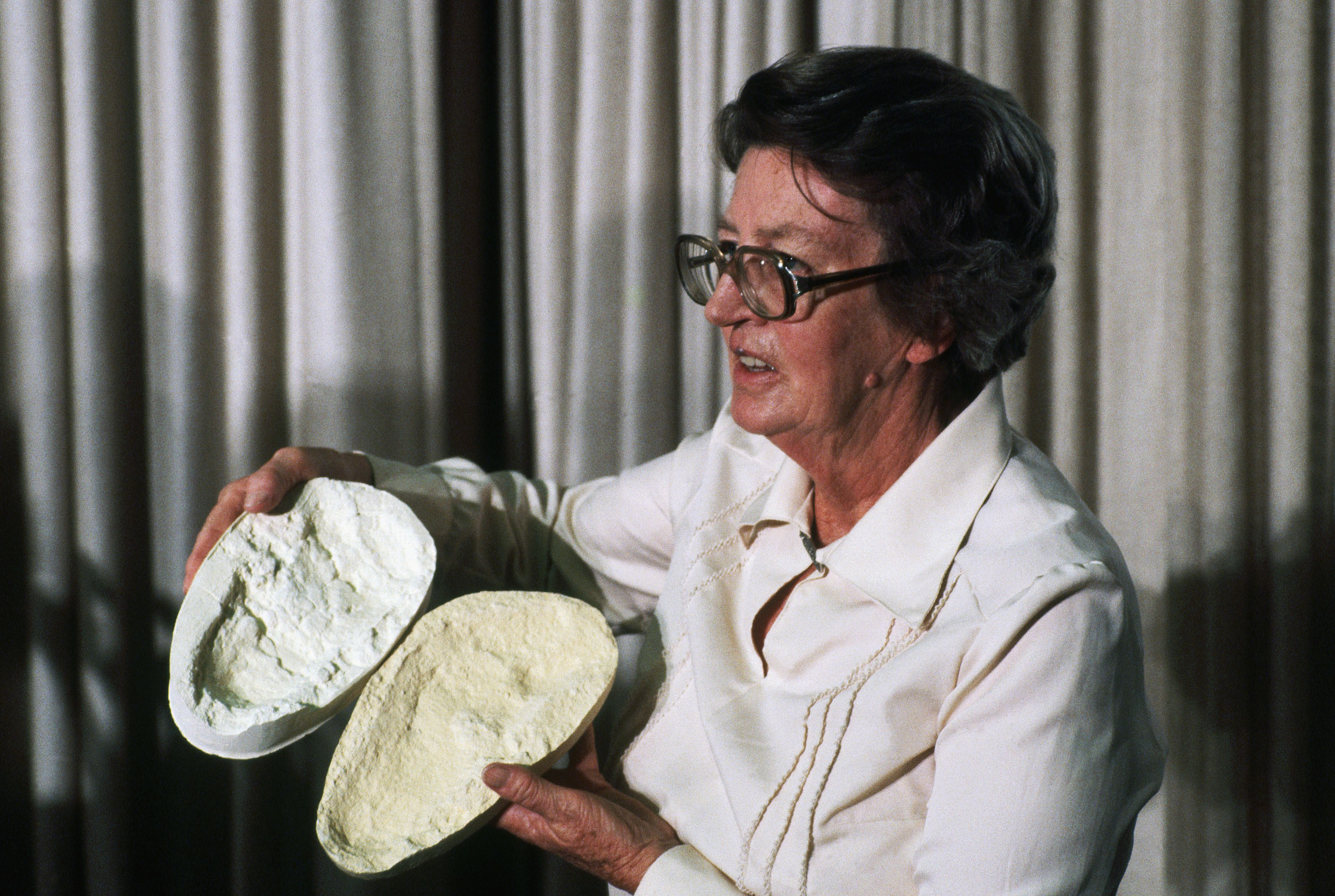 Mary Leakey Holding a Mold from a 3.6 Million Year Old Footprint