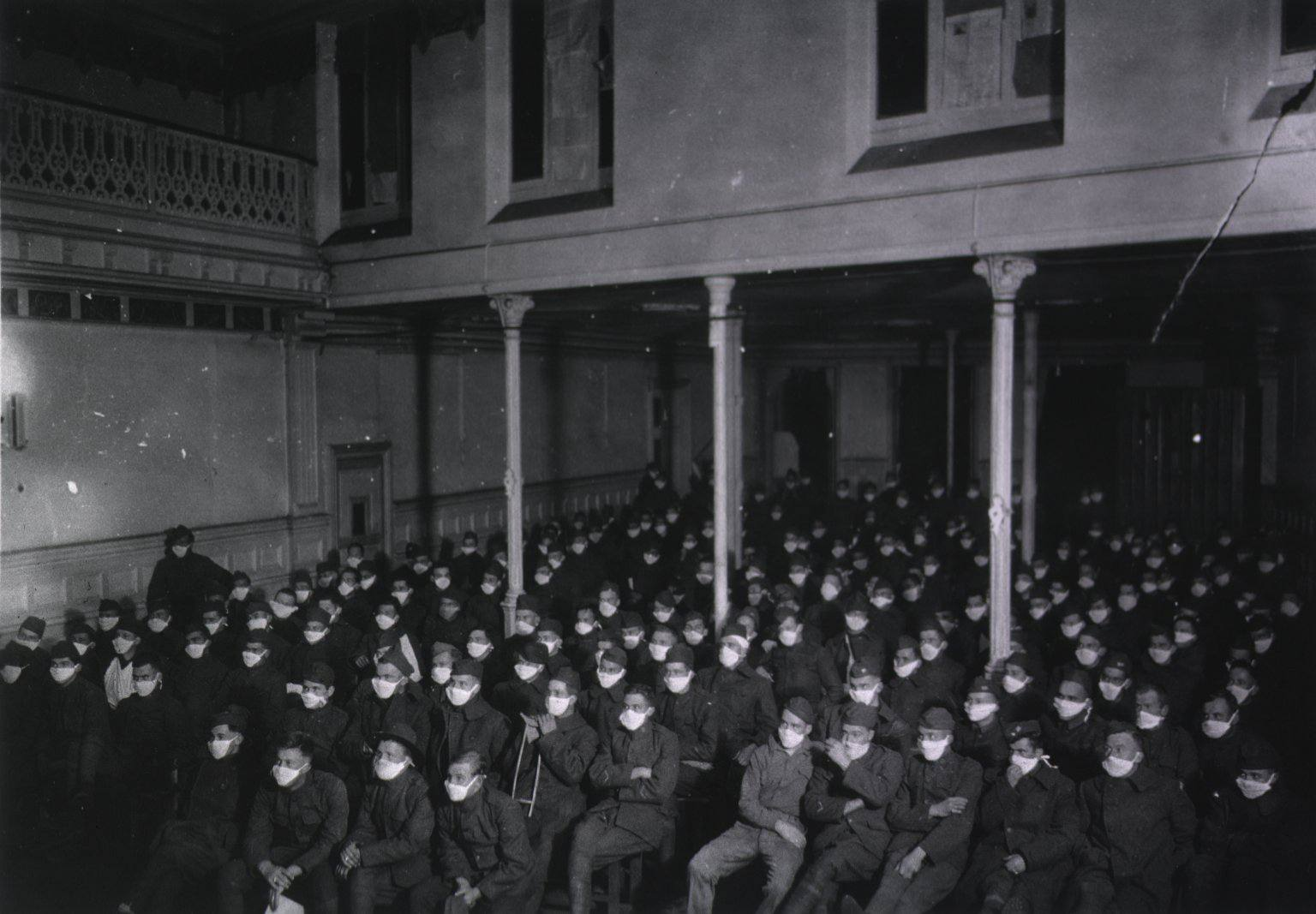 A picture of patients at a moving picture show wearing masks because of an influenza epidemic.