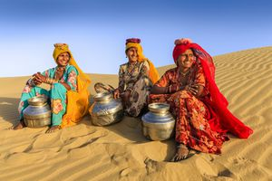 women carrying water from local well in Rajasthan, India