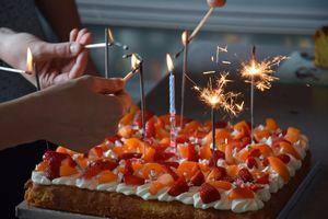 Lighting birthday candles on French tart