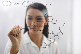 A female scientist drawing up a molecule