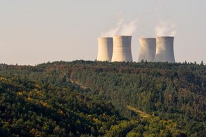 Cooling towers of a nuclear power plant Dukovany over the forest