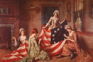 A painting of Betsy Ross and her assistants sewing the first American flag