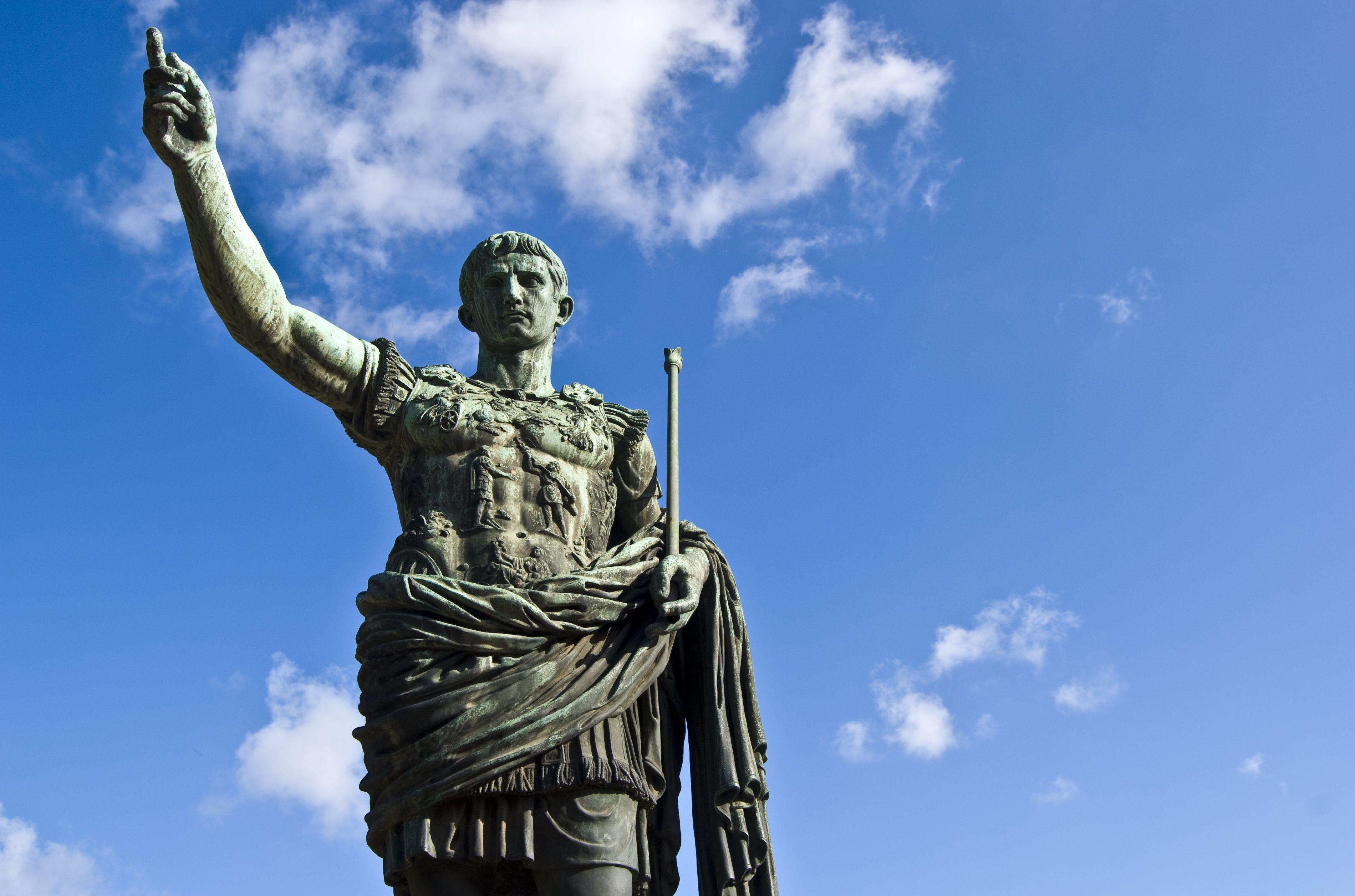 Statue of Julius Caesar against a blue sky.