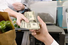 Customer paying at the checkout counter