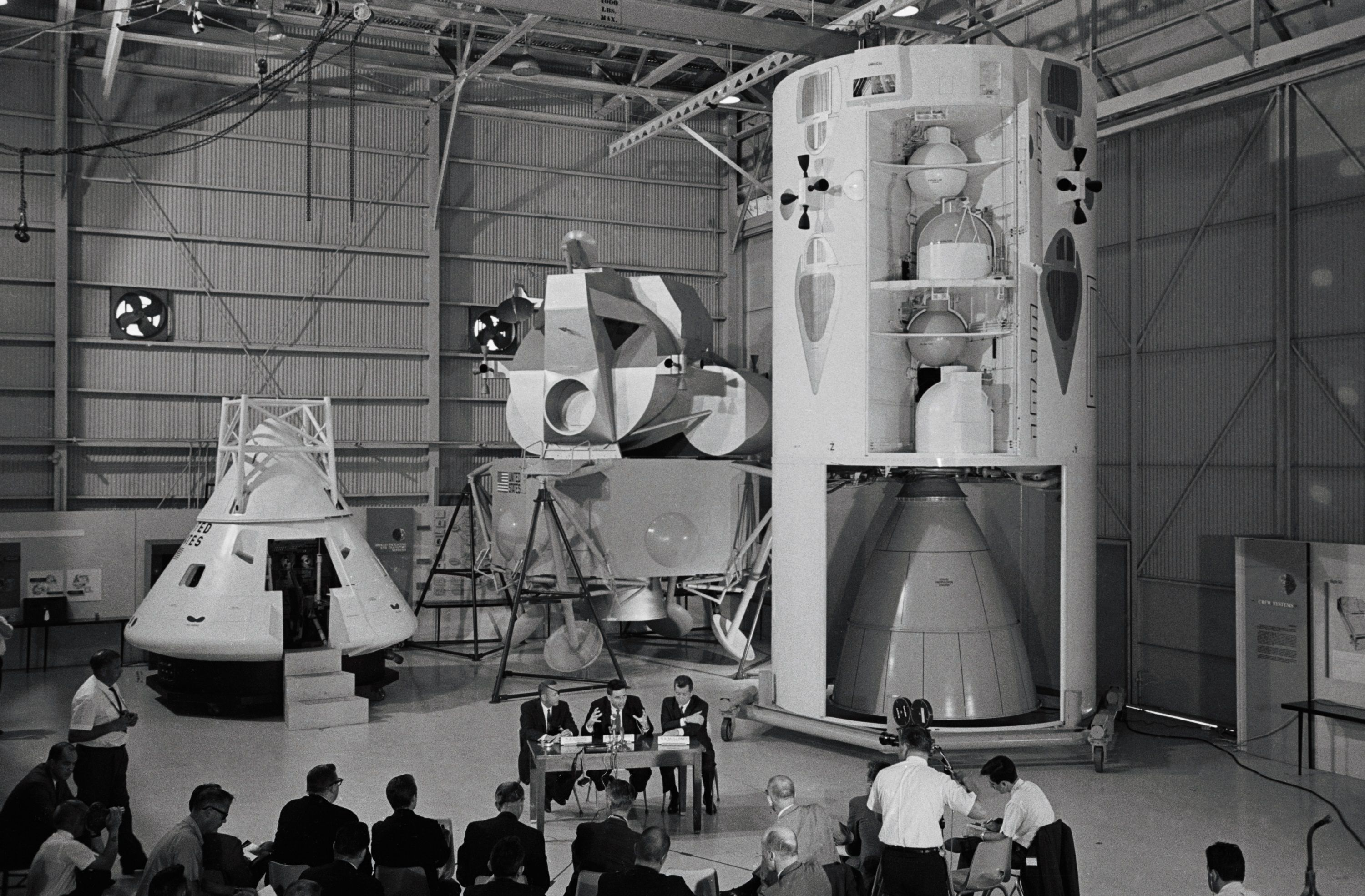 Models of Project Apollo components at a press conference