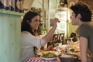 Happy young couple eating Italian together