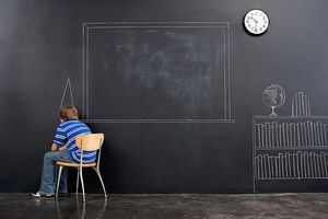 A boy sitting in the corner of a classroom wearing a dunce cap symbolizes the effect that a self-fulfilling prophecy can have on student achievement.