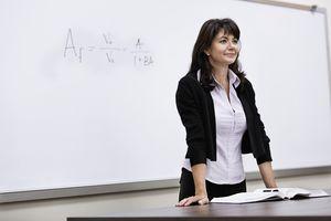 Teacher standing at whiteboard