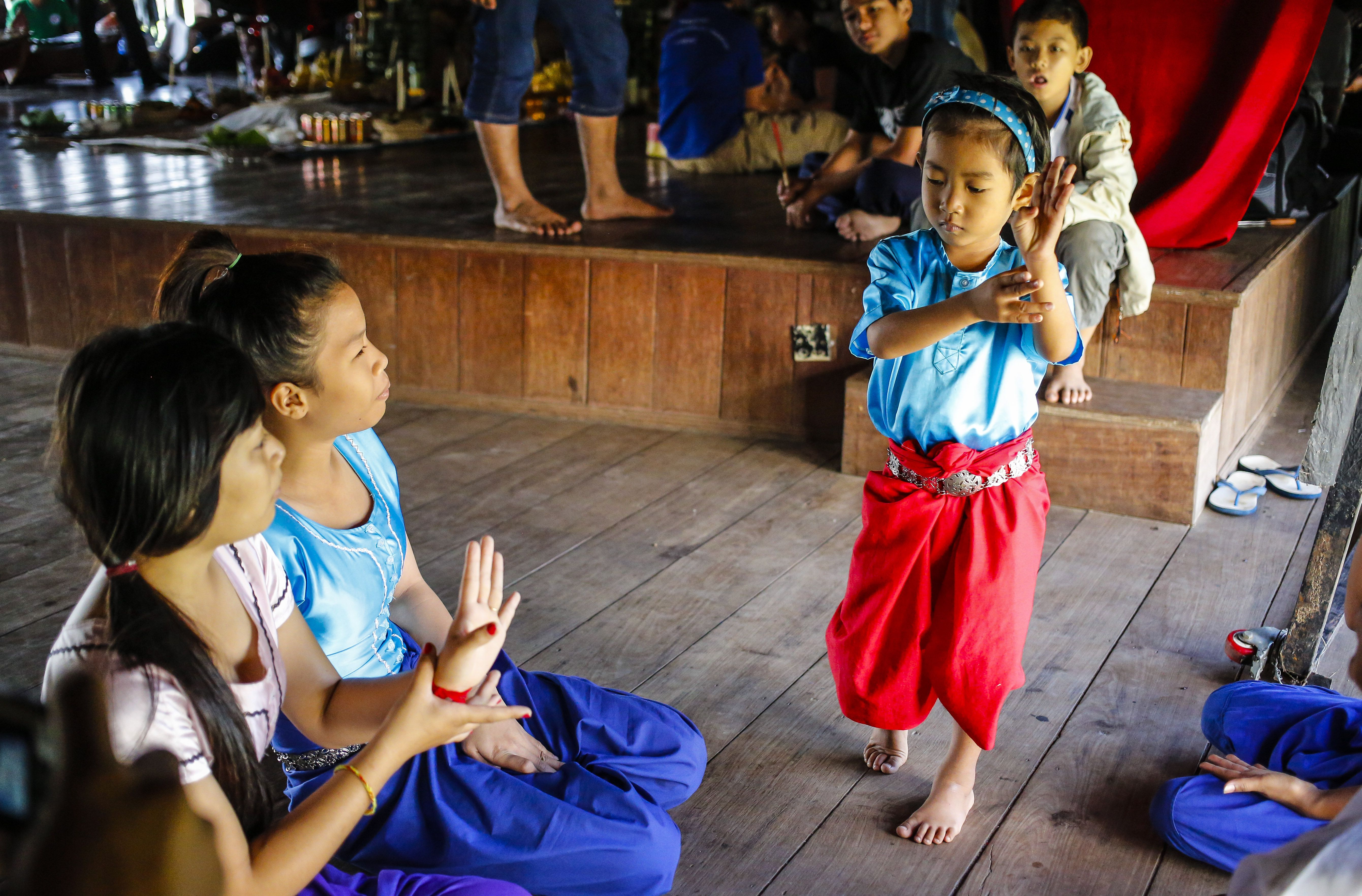 Kid learning traditional dance in Cambodia