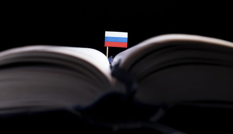 Russian flag in the middle of a book.
