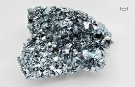 This is a photo of a crystal of ultrapure osmium metal.