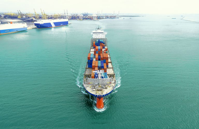 Container ship setting otu from port