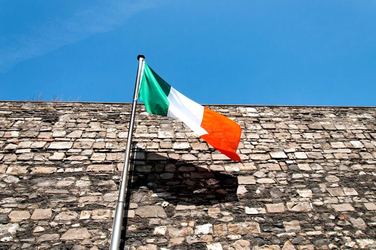 An Irish flag blowing in the wind