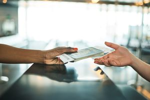 Handing over passport at immigration