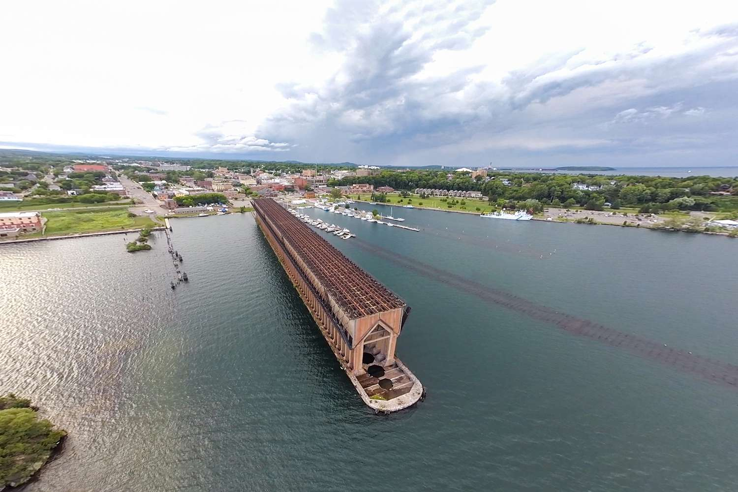 An aerial shot of the abandoned and iconic ore dock in Marquette, Michigan along the shore of Lake Superior.