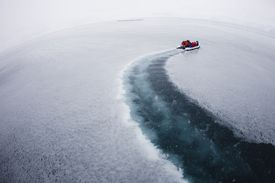 Boat on fresh sea ice