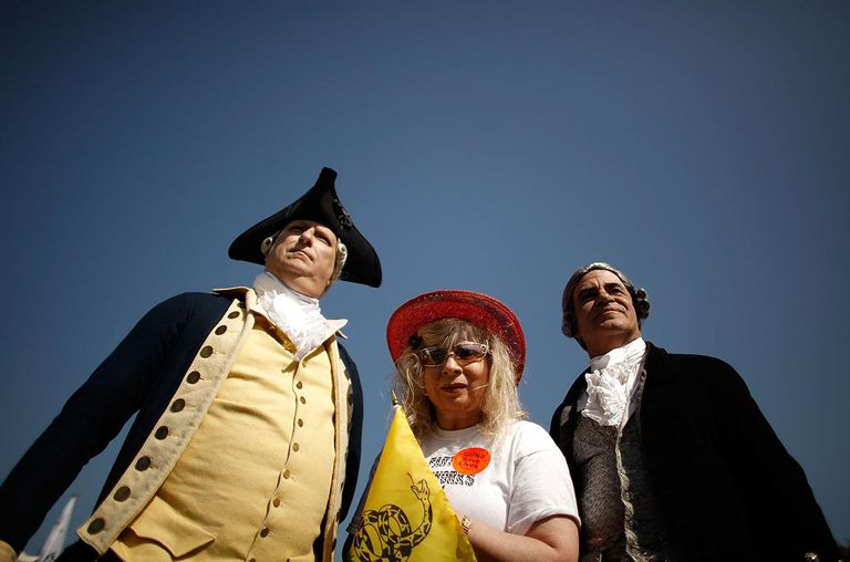 Historic re-enactors Kevin Grantz as George Washington and Gerry Notare as Patrick Henry pose for a photograph with Tea Party activist Nighta Davis of Hiawassee, Georgia