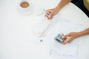 Woman at table paying bills