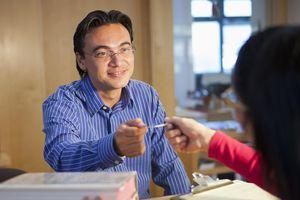 man handing customer a card