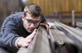 Worker in a steel shop