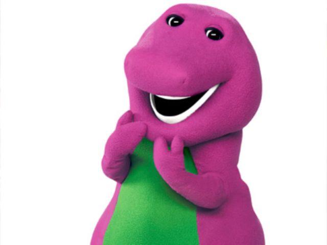 Barney the dinosaur smiling.