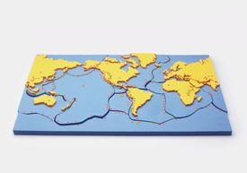 Model of the Earth showing the plates on the earth's surface, red dots showing eruptions of volcanoes