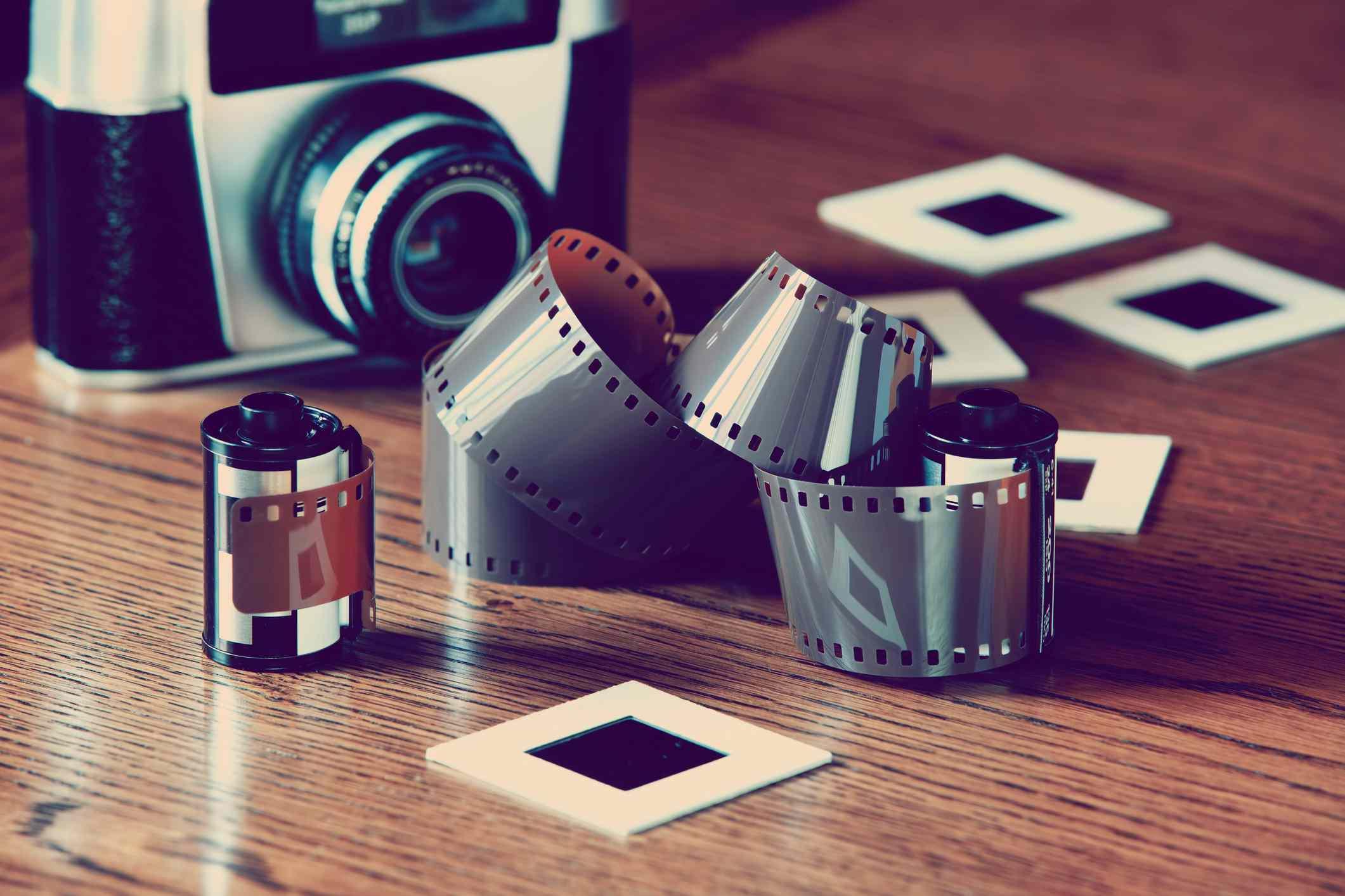 Unwound camera film, slides and camera