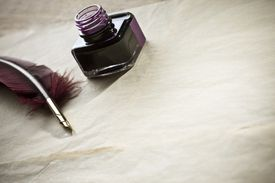 Pot of ink and quill