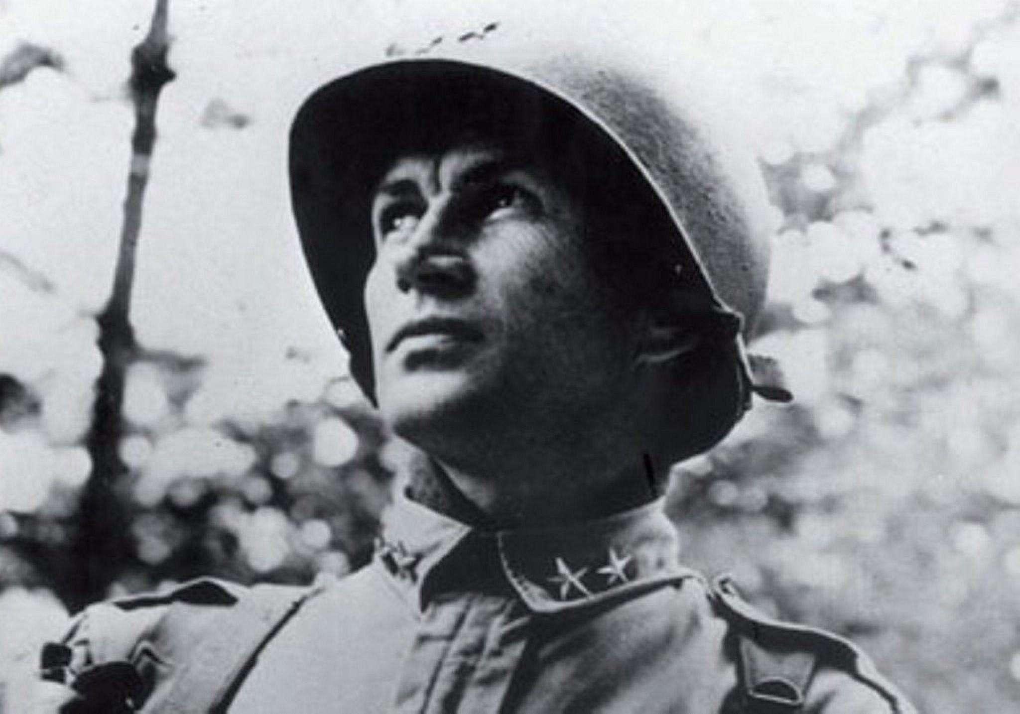 Major General James Gavin in uniform with helmet.
