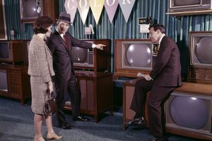 A couple in the 1960s looking at televisions