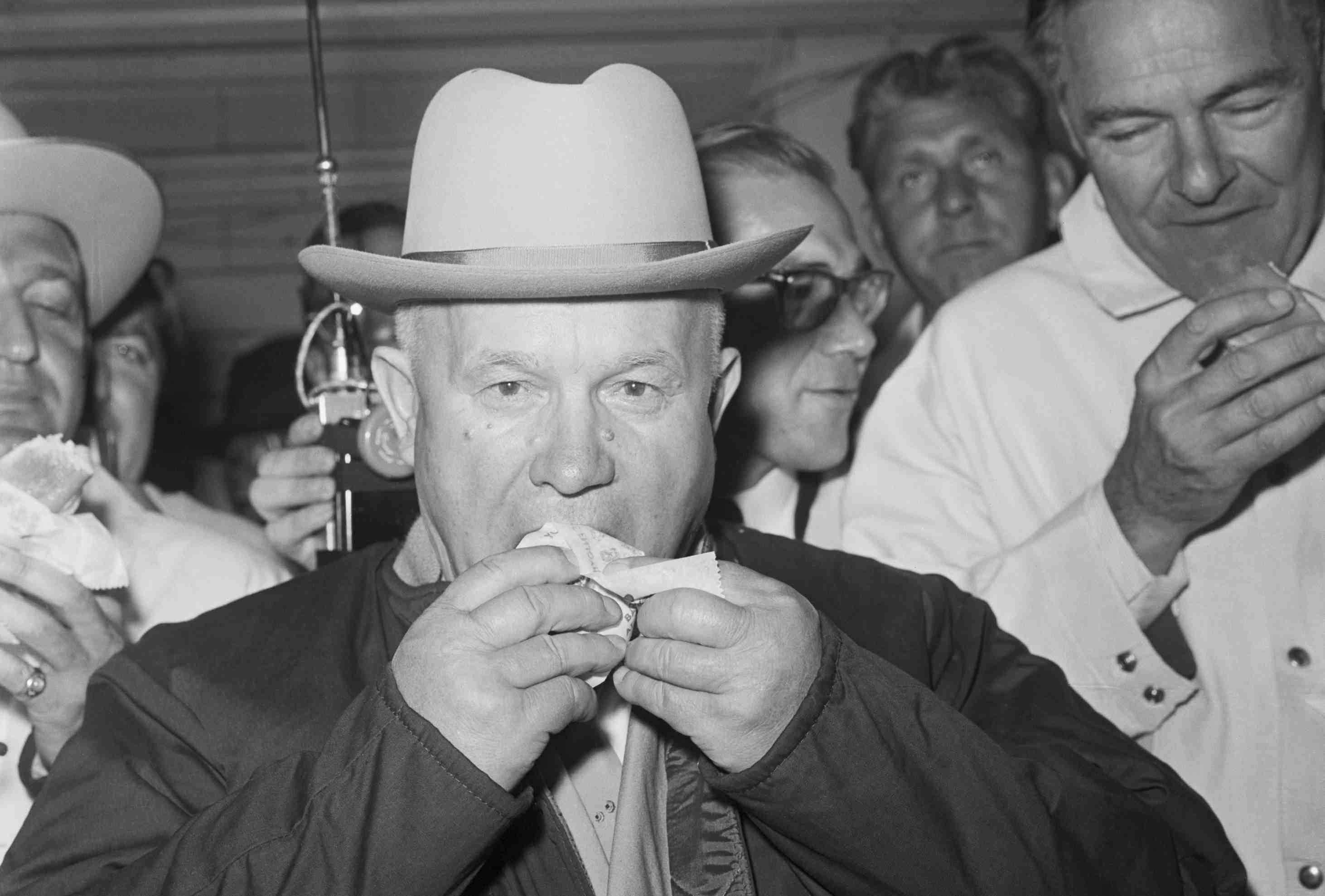 Nikita Khrushchev eating a hot dog.