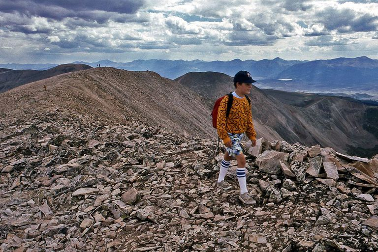 Ian Green hikes along the long summit ridge of Mount Sherman in Colorado